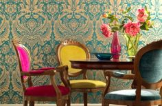 Colorful bohemian wallpaper and chairs in this dining room.  *************