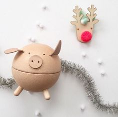 TLPAdventCalendar Door 15 is open! One little piggy. We love this piggy bank not only for the look and functionality but for the beautiful craftsmanship! This piglet is made of natural rubber wood trees in a sustainable workplace that gives back to children and our planet