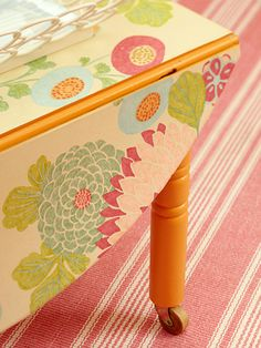 WALLPAPER TOP OF TABLE...Pin 2 of 2. Such a cute idea to wallpaper the top and drop-down leaves of a table. I would love to do this to my vintage runner table w/drop leaves in hall. Would add so much color our plain hall. Says wallpaper scraps work good.