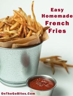 Our easy homemade French fries recipe hits the comfort food gold. Hand cut potatoes (or use a mandoline for ease), twice fried and seasoned with kosher or sea salt. Add your favorite flavored ketchup. The best fries ever. Or see our other recipes for oven baked fries. OnTheGoBites.Com #potatosides #comfortfood
