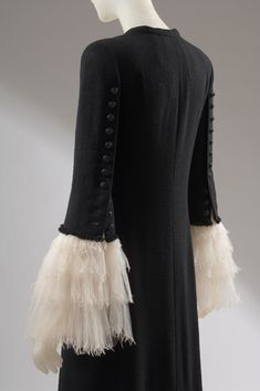 Karl Lagerfeld for Chanel coat of black wool and off white silk organdy. Fashion Institute of Technology: Daphne Guinness Exhibition.