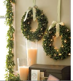 I love the idea of several smaller wreaths hung with ribbon over an empty wall.