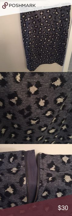 """Loft leopard print pencil skirt Super cute and comfortable pencil skirt with an edge! Charcoal color with leopard print detail. Fully lined, poly/ rayon/ spandex blend. Zip back detail. New with tags, never worn- excellent condition! Laying flat waist measures 15"""" and length measures 25"""" LOFT Skirts Pencil"""