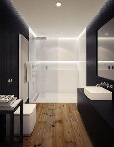 hardwood floor warms up this dark-walled bathroom...