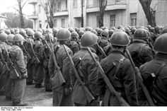 Rome, Italy, March 1944. Italian troops of the X MAS (belonging to the RSI Navy, and fighting as allied of the Germans) standing in viale Carso near piazza Bainsizza (Prati district), inspected by General der Luftwaffe Kurt Mälzer around the time this unit was deployed to counter the Allied beachhead at Anzio - Nettuno, south of Rome. Decima Flottiglia MAS = X MAS