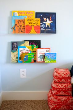 Clear shelves for displaying books!  Like this so much better than the raingutter bookshelves.