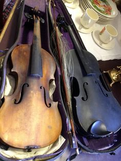 Antique violins at the Bay City Antiques Center - Bay City, Michigan (click through for more places to visit in Bay City, Michigan!)
