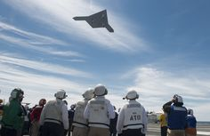 ATLANTIC OCEAN (May 14, 2013) An X-47B Unmanned Combat Air System (UCAS) demonstrator flies over the flight deck of the aircraft carrier USS George H.W. Bush (CVN 77). George H.W. Bush is the first aircraft carrier to successfully catapult launch an unmanned aircraft from its flight deck. (U.S. Navy photo by Mass Communication Specialist 2nd Class Timothy Walter/Released)