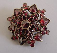 Garnets have been used as jewelry since 3100 B.C. Pictured is a Victorian Era brooch.  I have something very similar.. made in Czech..