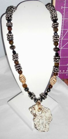 Vintage to Mod  Necklace Marble pendant of good weight Browns and creams Nice