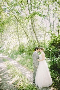 Vintage weddings are the perfect events to use the outdoors as your main photo backdrop. Holly and Jeff found this pathway near their venue and we drove for their couple photos.  Photography by Clane Gessel Photography | #weddings #photography #brideandgroom