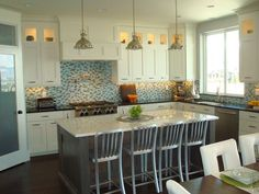 different colour benchtops, grey island - splashback is a bit too busy