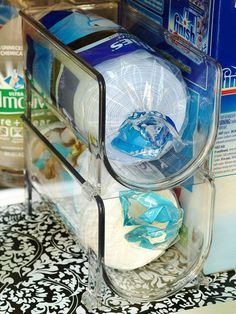 Refrigerator wine bins are just the right size for rolls of garbage bags: http://www.bhg.com/decorating/storage/projects/cabinet-and-undersink-storage-solutions/?socsrc=bhgpin021614breakoutofthebox&page=11