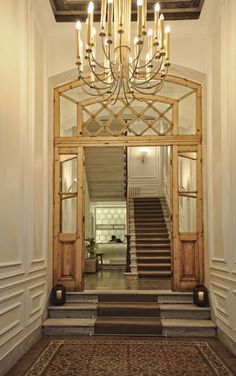 like this idea of an entry vestibule (probably with coat closets on either side in my version), with the few steps up into the formal foyer.  like that sense of arrival.