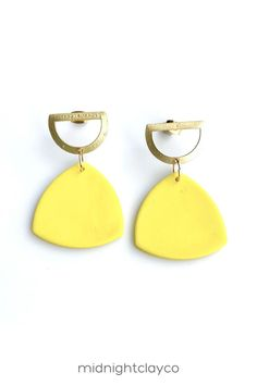 Yellow polymer clay earrings. Triangle shaped dangle earrings with gold cut out semicircle shaped studs. Unique minimalist earrings makes a bold accessory for a summer or fall girls night outfit. Give as a unique birthday gift for aunt, niece, or sister in law. Makes a great summer birthday gift! Shop these trendy handmade earrings for women in my etsy shop! Yellow Earrings, Women's Earrings, Minimalist Earrings, Minimalist Jewelry, Earrings Handmade, Handmade Jewelry, How To Clean Earrings, Aunt Gifts, Unique Birthday Gifts