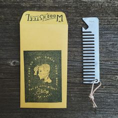 """Designed and laser cut here in Indiana, I hand stamp each comb with my branch logo and then clean them up with a stonewashed or tumbled finish. """"Fix your do and crack your brew."""" Lightweight and thin, this comb was designed to be carried without even knowing it's there. 100% stainless steel and made in USA!"""