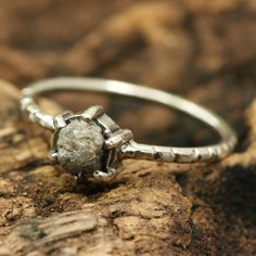 Oval rough diamond ring in prongs setting with sterling silver oxidized texture band