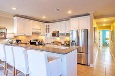 This home located in Grayton Beach along highway 30A in Santa Rosa Beach, FL puts the other beach condos to the test!   It's open concept floor plan and spacious kitchen with custom built cabinets and stainless appliances, make this beach condo perfect fo