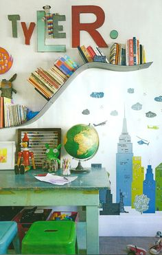 Cool kids room. Green and blue Tolix stools. Bookshelf is Bookworm by Ron Arad for Kartell.