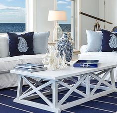 Coffee table decor inspired by the salt, sand & sea. Coastal Living Rooms, Home Living Room, Living Room Furniture, Living Room Decor, Furniture Slipcovers, Decorating Coffee Tables, Sectional Sofa, Home Furnishings, Console Tables