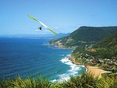 Hang Gliding over some exotic tropical location that looks like Jurassic Park...