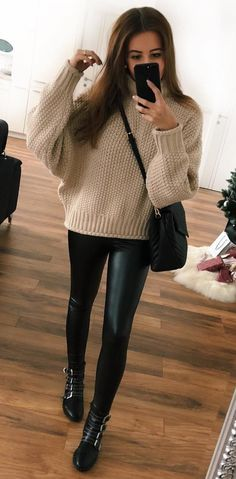 #winter #outfits  brown long-sleeved and black jeans