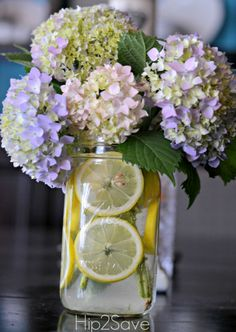 Lemons and flowers in a mason jar - don't think I will do this but it looks great!