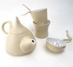 tea for two ritual teapOt with navel-mugs and teasieve. €130,00, via Etsy.