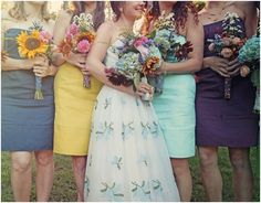 Love everything about this, the bouquets and the different bridesmaid dresses!
