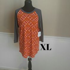 LuLaRoe Randy Tee This unisex knit shirt resembles a baseball tee with its raglan, mid length sleeve in a contrasting, patterned fabric. It's everything a tee shirt should be: stylish, easy, and comfortable! Wear with a pair of jeans or leggings. Happy hunting!! LuLaRoe Tops Tees - Long Sleeve