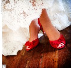 """The bride wore bold red shoes to go with her favorite """"Angel Red"""" lipstick by Clinique. The bridesmaids loved the vintage look so much, they borrowed the lipstick to coordinate with their bouquets."""