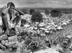 A young refugee sits on the walls of Purana Qila, transformed into a vast refugee camp in Delhi, 1947 / Photograph by Margaret Bourke-White