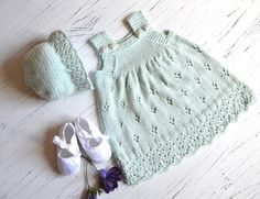 Sweet little sun dress with matching hat. Find the pattern on LoveKnitting.com!
