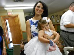 This little angel is the groom's niece and was a beautiful little flower girl, waving her American flag.