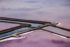 Amazing Photos from Around the Net: Artificial river next to purple waters