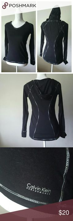 """Calvin Klein black long sleeve fitness hoodie Calvin Klein black long sleeve fitness hoodie Perfect condition, super figure flattering and comfortable. The thin quick dry fabric is perfect for the gym! Look cute while working out! Very soft fabric, no holes or stains. Grey piping.  Measurements while laying flat: Bust 19"""" Sleeves 24"""" Length 25"""" Calvin Klein Tops Sweatshirts & Hoodies"""