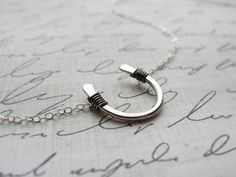 Horseshoe Necklace in silver too