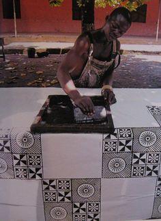 Africa | Screen printing using Adinkra symbols. | Photographer unknown