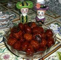 Meatballs in grape jelly and chili sauce (@Heather Creswell Creswell McCoy)