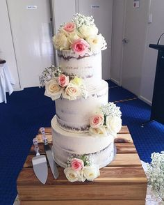 Closer view of the sweet and simple wedding cake that went out on Friday for Mr and Mrs Nash! Love the combo of roses and babies breath on the semi-naked cake, Classic and perfect! #weddingcake #wedding #seminakedcake #roses #babiesbreath #acdnmember