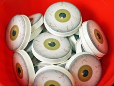 Remove backing from label and apply one eyeball to the flat back of each tube cap (Image 2). Fill pairs of bottles with Halloween-themed items.