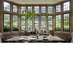 The view through the new bay window in the kitchen to the box parterre in the garden at Asthall Manor, home to the Mitford family from 1919 to 1926. The house was built in the early 17th century and altered by the Bateman family in the 1890s and by Lord Redesdale in the 1920s. Pub Orig CL 23/09/2009