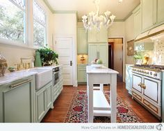 A Portland kitchen with a white and green motif and was accentuated with red printed area rug which made the white island pop out. Subtle technique.
