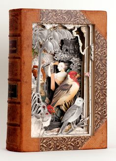 """Alexander Korzer Robinson ~ """"I make book sculptures / cut books by working through a book, page by page, cutting around some of the illustrations while removing others. The images seen in the finished work, are left standing in their original place."""""""