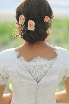 low twisted wedding updo with peach flowers and a veil would make this perfect!