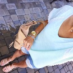 IG @mrscasual <click through to shop this look> Mint top. Destroyed denim jeans shorts. Jeweled sandals. Tan bag. Kendra Scott