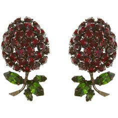A gorgeous pair of vintage earrings from the 1950s are designed in the shape of a raspberry and feature deep, rich hues of red and green. Wear with a festive o…