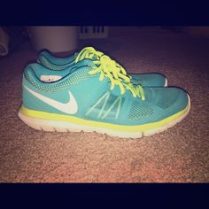 Green NIKE flex 2014 run Lightly worn and in great condition! Nothing wrong with these shoes, I just have too many and need to get rid of some! Nike Shoes Athletic Shoes