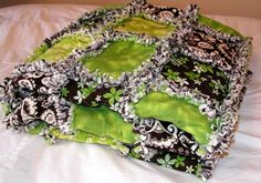 Large rag quilt in browns and greens