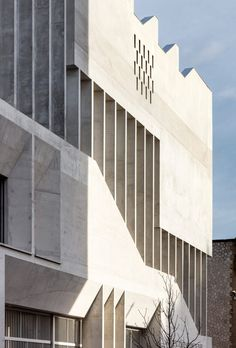 The monolithic, brutalist building is L-shaped in plan and was cast in situ using light-hued coquina-sand concrete. Brutalist Buildings, Concrete Column, Outdoor Play Spaces, Eco City, City Block, Grey Brick, Cultural Architecture, Canopy Cover, Interesting Buildings